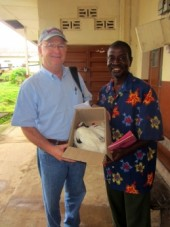 Dr. Maggi receives gift of chicken for his surgery for this man's wife.